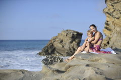 Woman and child on the rocky beach. Royalty Free Stock Photo
