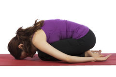Woman in Child's Pose during Yoga stock photos