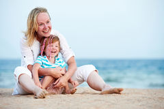 Woman and child at sea beach Royalty Free Stock Photo