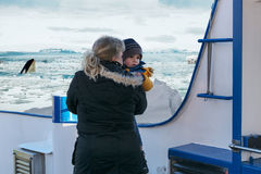 Woman with child on a ship during a polar trip. Stock Photography