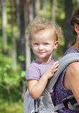Woman with child in sling outdoor Royalty Free Stock Images