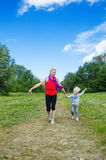 Woman with a child on the sports outing Stock Images