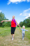 A woman with a child on the sports outing Stock Photos