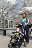 Woman with child in stroller Stock Photos