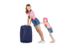Woman and child with a suitcase Stock Photography