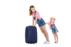 Woman and child with a suitcase Royalty Free Stock Image