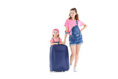 Woman and child with a suitcase. Beautiful young mother and lovely daughter is going on a trip. women and child with a suitcase on castors on white background Stock Image