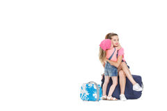 Woman and child with a suitcase. Beautiful young mother and lovely daughter is going on a trip. women and child with a suitcase on castors on white background Royalty Free Stock Photo