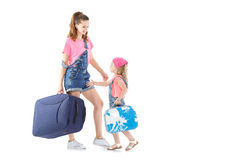 Woman and child with a suitcase Royalty Free Stock Photo