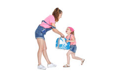 Woman and child with a suitcase Stock Images