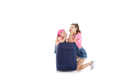 Woman and child with a suitcase Stock Photo