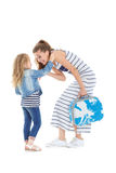 Woman and child with a suitcase. Daughter tickles mom. women and child with a suitcase on castors on white background Stock Photo