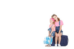 Woman and child with a suitcase. Young mother and lovely daughter tired expect . women and child sitting on suitcase on white background Stock Images