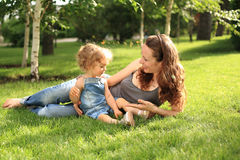 Woman with child in summer park. Woman with child having fun in summer park royalty free stock photography