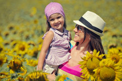 Woman and child with sunflower Stock Images