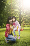 Woman and child taking selfie at park Royalty Free Stock Images