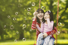 Woman and child touching bubbles Stock Image