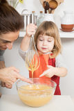 Woman and child touching whipped cream Stock Images