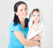The woman with the child in a towel Royalty Free Stock Image