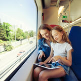 Woman with child traveling by public transport Royalty Free Stock Photos