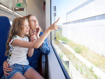 Woman with child traveling by public transport Stock Photo