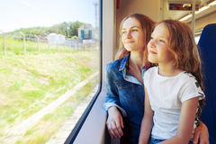Woman with child traveling by public transport Stock Photography
