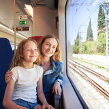 Woman with child traveling by public transport Royalty Free Stock Image