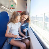 Woman with child traveling by public transport Royalty Free Stock Photo