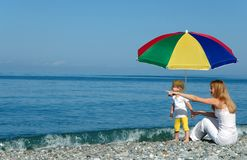 Woman and child under umbrella Stock Photo