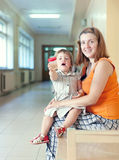 Woman with child with urinalysis sample Royalty Free Stock Image