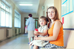 Woman and child  with urinalysis sample Stock Photos