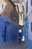 Woman and child walking in Chefchaouen. Morocco Royalty Free Stock Photography