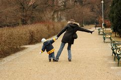 Woman and child walking in the park. Royalty Free Stock Images