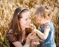 Woman and child in wheat field Royalty Free Stock Photo