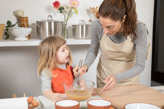 Woman and child whipping and speaking Stock Photography