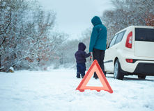 Woman with a child on the winter road. Stock Images