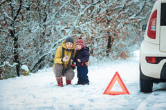 Woman with a child on the winter road Royalty Free Stock Photos
