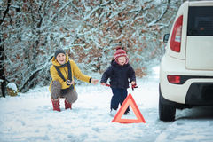 Woman with a child on the winter road Stock Image
