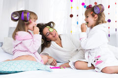 Woman and children on bed Royalty Free Stock Photos