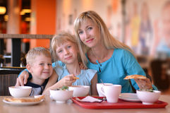 The woman and children in cafe. The young women and two children in cafe Stock Photography
