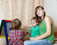 Woman and children draws on  blackboard Royalty Free Stock Image