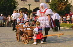 Woman and children in folk costumes Royalty Free Stock Photo