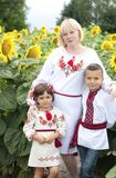 Woman and children in national Ukrainian costumes. stock photos