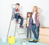 Woman and children painting wall Royalty Free Stock Photography