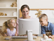 Woman and Children Playing on Computer Royalty Free Stock Photo