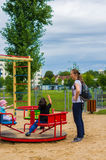Woman and children by roundabout stock images