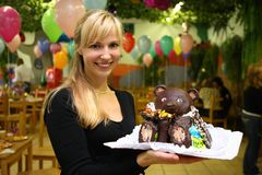 Woman on children's holiday with chocolate bear Royalty Free Stock Image