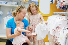 Woman with children in shop Stock Image