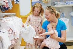 Woman with children in shop Royalty Free Stock Images