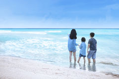 Woman and children standing at coast Royalty Free Stock Photography
